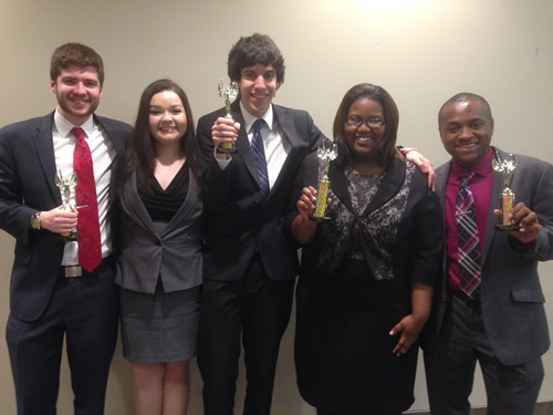 PSC Speech Team Members pose with trophies.