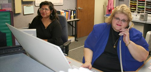 Raquel and Denise working in the Information Center