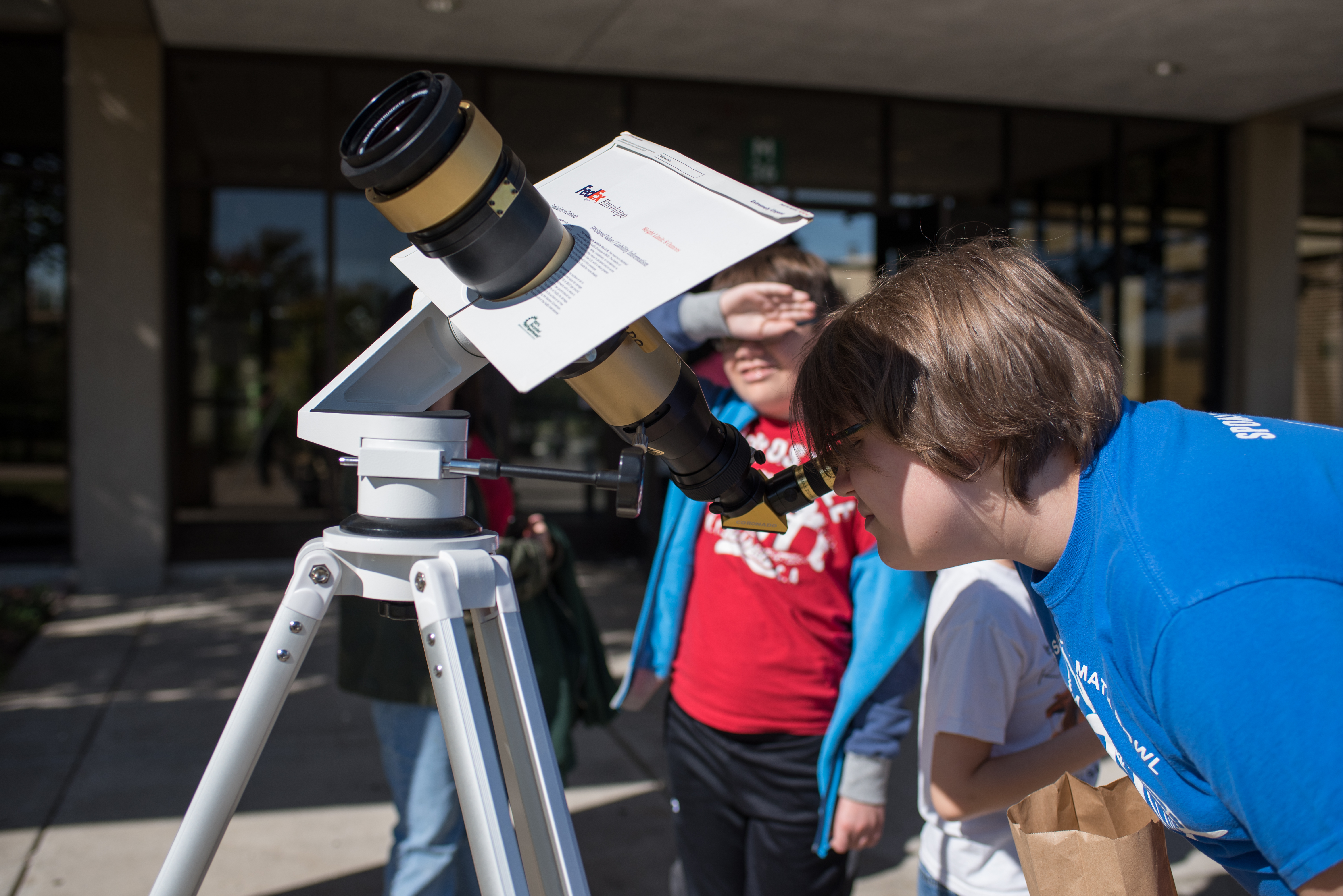 Students visiting Prairie State College (PSC) take turns looking at the sun through a solar telescope during the STEM@PSC iDiscover STEM Fun Day event.
