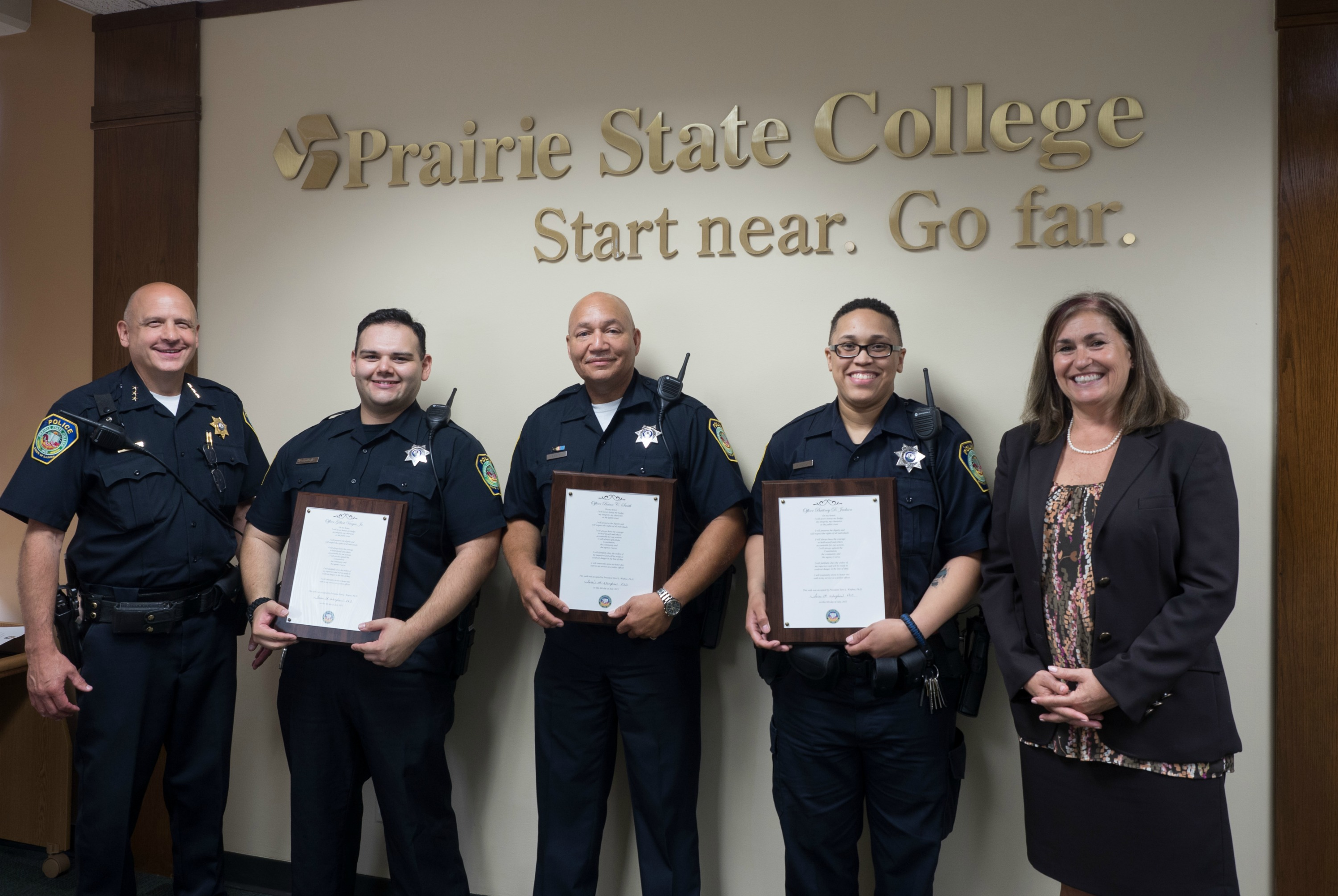 Prairie State College (PSC) Police Chief John P. Murphy, Sr. (left), and President Dr. Terri L. Winfree (right) congratulate newly sworn in officers to the PSC Police Department (from second from left) Gilbert Vargas, Jr., Brian C. Smith, and Brittney D. Jackson.