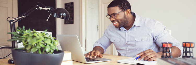 African American man at home computer doing class work