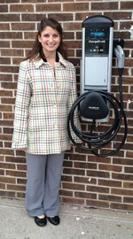 Allessandra standing next to Electric Vehicle Charging Station
